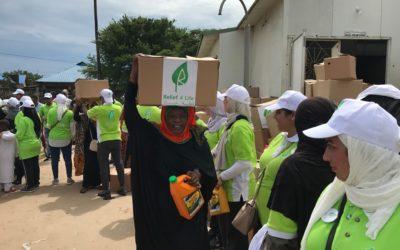 Distributing food bins in Tanzania and Zanzibar island