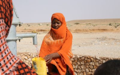 Signing an agreement to build wells