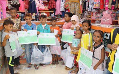 Distributing Eid clothes for Yemeni refugees children